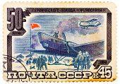 Stamp Printed In Ussr (russia) Shows Plane, Rescue Crew With Inscription And Name Of Series