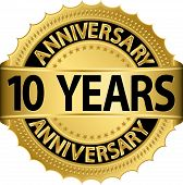 stock photo of rosettes  - 10 years anniversary golden label with ribbon - JPG