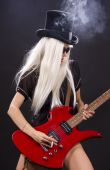 image of rock star  - woman in top hat with red electric guitar and cigarette - JPG