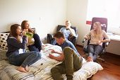 picture of underage  - Group Of Teenagers Drinking Alcohol In Bedroom - JPG