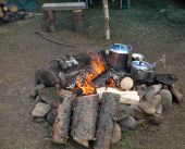 picture of tarp  - a meal cooking on a fire during a camping trip - JPG
