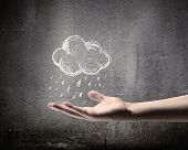 stock photo of rain clouds  - Background conceptual image with raining cloud in hand - JPG