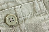 picture of khakis  - Macro of khaki pants pocket button cotton textile great details - JPG