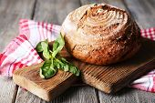 stock photo of cutting board  - Fresh baked bread and fresh basil on cutting board - JPG