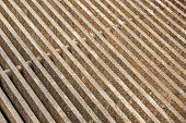 stock photo of metal grate  - The thick rusty metal grate with a rough texture - JPG