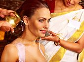 picture of panchakarma  - Woman having Ayurvedic spa treatment - JPG