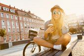 pic of casual woman  - Young stylish woman with a bicycle in a city street - JPG