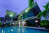 picture of house plant  - Modern house with swimming pool at night - JPG
