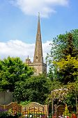 stock photo of church-of-england  - St John the Baptist church spire Burford Oxfordshire England UK Western Europe - JPG
