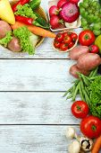 picture of abundance  - Summer frame with fresh organic vegetables and fruits on wooden background - JPG