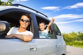 picture of car-window  - Happy Little Boy and  Father travel by car - JPG