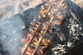 foto of brazier  - The shish kebab prepared on a brazier and the crackling rings of fried onions - JPG