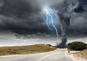 stock photo of hail  - Powerful tornado and lightning above countryside road - JPG