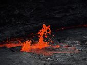 foto of magma  - Lava burst inside the Erta Ale volcano - JPG