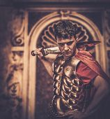 image of legion  - Roman legionary soldier in front of ancient building - JPG