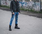 picture of anarchists  - Punk guy with boots posing in the city streets - JPG