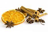stock photo of cinnamon sticks  - dried orange rings with some anise stars and cinnamon sticks - JPG