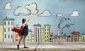 stock photo of heroes  - Cute girl of school age wearing super hero costume - JPG