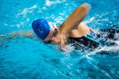 pic of crawling  - Female swimmer in an indoor swimming pool  - JPG