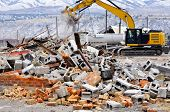 picture of backhoe  - Detail of demolition of building collapse bricks wall - JPG