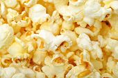 foto of popcorn  - close up vief of yellow popcorn as background - JPG