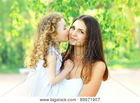 Mother\'s Day, Family, Childhood And People Concept - Loving Daughter Kissing Mother, Happy Young Mom