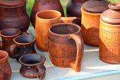 picture of ceramic bowl  - Ceramic brown mug among ceramic ware - JPG