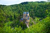 stock photo of moselle  - Eltz castle view from above among forest hills Muenstermaifeld, Mayen-Koblenz, Rhineland-Palatinate, Germany ** Note: Shallow depth of field - JPG