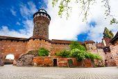 stock photo of bavaria  - The beautiful Kaiserburg wall with Sinwellturm and inner yard in Nuremberg - JPG