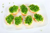 image of chive  - Bread with chopped chives on a plate - JPG