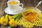 pic of dandelion  - Flower tea in a white cup jam of dandelions and flowers dandelions on a yellow knitted napkin - JPG