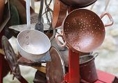 image of flea  - old collander and other old copper objects in cart for sale at flea market