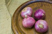 stock photo of onion  - Onion and spring onion on sack background - JPG