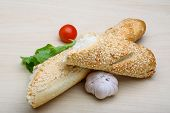 image of crust  - Fresh crust Baguette with sesame seeds and salad - JPG