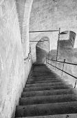 picture of bannister  - Black and white take of a staircase inside a medieval castle - JPG