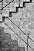 picture of bannister  - Abstract take of a staircase on an old stone wall - JPG