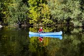stock photo of canoe boat man  - View of the young man rowing in a canoe - JPG