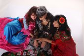 picture of gypsy  - Three gypsy women posing in traditional outfits - JPG