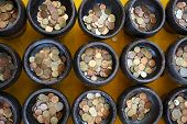 image of copper coins  - donate Thai coin in Buddhist monk