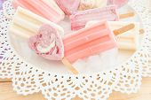 picture of popsicle  - Variety of frozen fruit popsicles on vintage plate - JPG