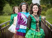 pic of wig  - Three young beautiful girls in irish dance dress and wig posing outdoor  - JPG
