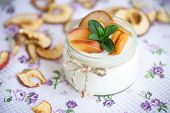 stock photo of dry fruit  - home sweet yogurt with dried fruit cooked in a glass jar - JPG