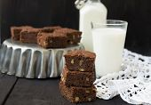stock photo of brownie  - Chocolate brownies on a dark background  - JPG