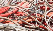 pic of dump  - red electrical wires and other lengths of copper wire in the dump of special material - JPG
