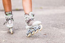 picture of inline skating  - Enjoying roller skating rollerblading on inline skates sport in park - JPG