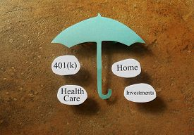 picture of retirement  - Retirement and investing terms under a paper umbrella  - JPG