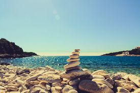 image of stability  - Stones balance at the vintage beach inspirational summer landscape - JPG