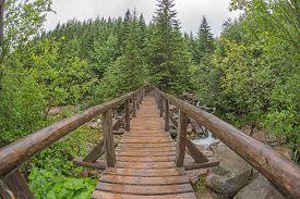 stock photo of distort  - View of wooden bridge over the river  - JPG